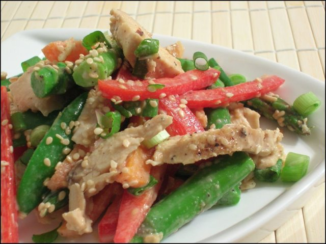 Chinese Chicken Salad with red bell peppers, asparagus, carrots and snowpeas in a smooth sesame dressing
