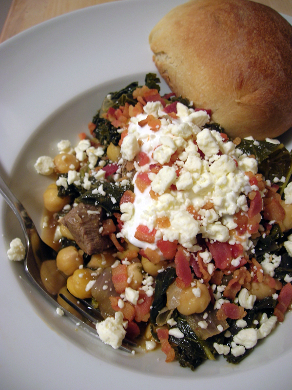 Rustic Greens and Garbanzo Beans with Beef, topped with Greek yogurt, feta cheese, and bacon. Yum.